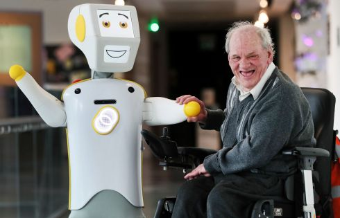 STEVIE II: Ireland's first socially assistive AI robot 'Stevie II' from robotics engineers at Trinity College Dublin, with Brendan Crean, who helped trial the robot through the charity Alone, during a special demonstration at the Science Gallery in Dublin. Photograph: Brian Lawless/PA Wire