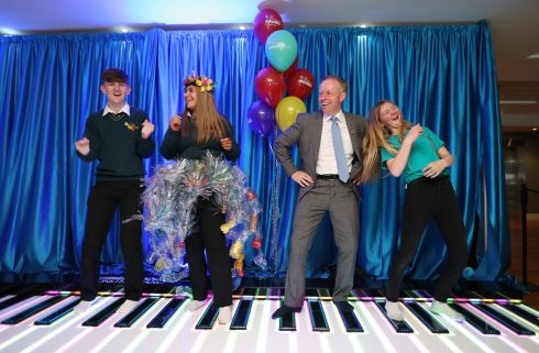 PIANO MAN: Minister of State for the Diaspora, Ciarán Cannon tries a dance off on a giant piano with students from Gaelcholáiste Chéitinn, Clonmel, Co Tipperary, Kerri O' Regan (16) and Jim Moroney (16)and Emma Keating from Coláiste Muire, Ennis, Co Clare at the Young Social Innovators of the Year Ireland Awards at Croke Park, Photograph: Julien Behal