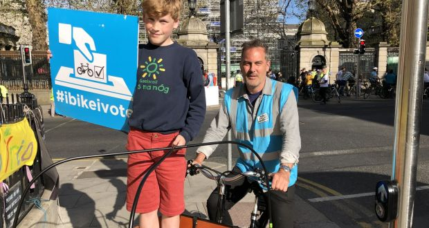 Ruairí Walsh and his father, Colm, at the Dublin Cycling Campaign demonstration outside Dail Eireann on Wednesday. Photograph: Mark Hilliard/Irish Times