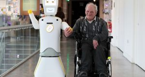 Stevie II  pictured with Brendan Crean, who helped trial the robot through the charity Alone, during a demonstration at the Science Gallery in Dublin. Photograph: Brian Lawless/PA Wire