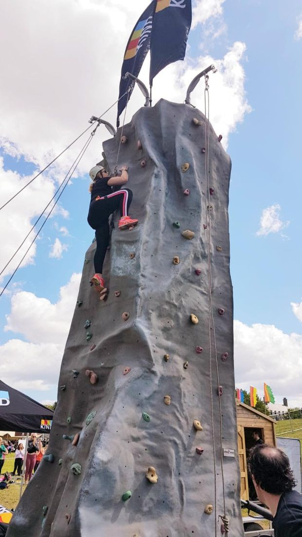 Rachel Flaherty takes on the climbing wall at Wellfest festival in Dublin.