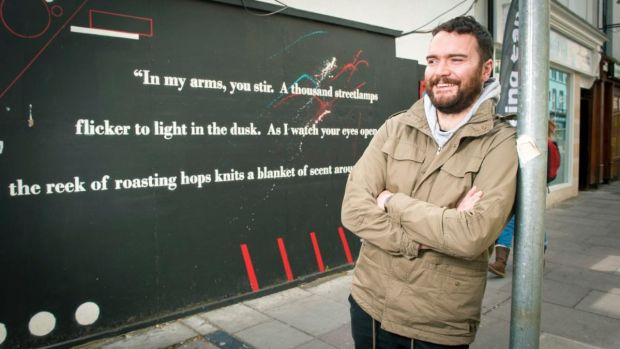 Kevin O'Brien of Mad About Cork beside one of the group's murals on North Main Street in Cork. Photograph: Daragh McSweeney/Provision
