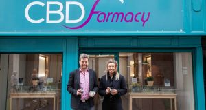 CBD Farmacy managing director pictured with pro-MMA fighter Leah McCourt outside the first retail outlet for cannabis-based products in the North.