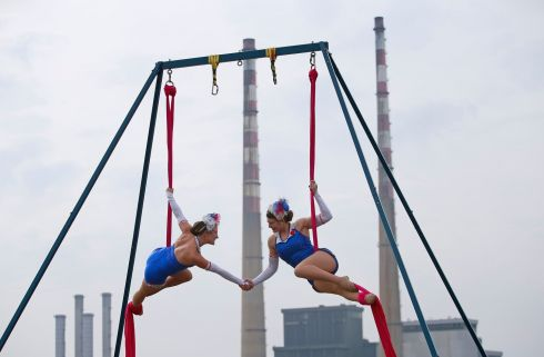 ON A ROPE: Canadian aerial acrobats, Molly Keczan and Glory Dearling from The Silver Starlets, have swung into Dublin in style to launch Laya Healthcare's City Spectacular festival. They performed aerial poses together from their 25 foot tall rig against the  backdrop of the Poolbeg Power Station towers.  Photograph: Nick Bradshaw/The Irish Times