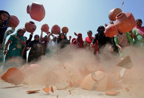 SMASHING TIME: Women throw earthen pitchers onto the ground in protest against the shortage of drinking water outside the municipal corporation office in Ahmedabad, India on May 16th. Photograph: Amit Dave/Reuters