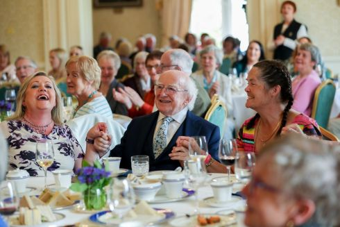 President Michael D Higgins sings with Helen Stokes (left) and Marie Tolan (right) at afternoon tea for active retirement groups from all around the country in Áras an Uachtarán. By hosting the event, the President and Sabina pay tribute to people of all ages and circumstances who are working to build solidarity and cohesion in our country. Photograph: Maxwell Photography
