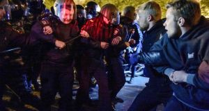 Riot police confront activists protesting against a plan to build an Orthodox cathedral in a park in the Russian Urals city of Yekaterinburg. Photograph: Alexei Vladykin/AFP/Getty