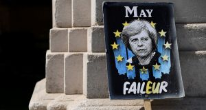 An anti-Brexit placard depicts British PM Theresa May: She  will meet 1922 Committee chairman Graham Brady after the second reading of the Withdrawal Agreement Bill  in the first week in June. Photograph: Toby Melville
