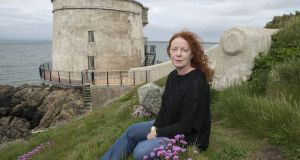 Journalist Rosita Boland at the Martello Tower in Sutton. 'She is a writer who, striking out alone and courageously, learned her trade in the University of Life.' Photograph: Dave Meehan