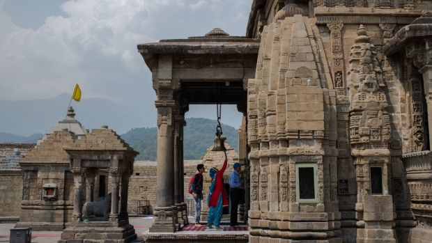 Devotees walk through the Shiv Temple in Baijnath, India. Photograph: Rebecca Conway/The New York Times
