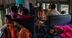 Passengers ride the train from Joginder Nagar, India. The 160km journey from the  city of Pathankot, in the state of Punjab, to Joginder Nagar, takes 10 hours. Photograph: Rebecca Conway/The New York Times