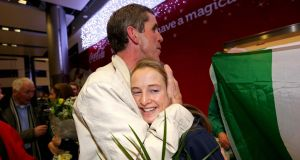 DCU's athletics academy director Enda Fitzpatrick with Irish Olympian Fionnuala Britton. Photograph: Ryan Byrne/Inpho