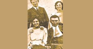 The wedding photograph of Dan Breen shows him with his Luger pistol on his lap. With him is his wife, Bridget Malone. In background: Seán Hogan and Bridget's sister, Áine Malone.