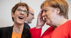 Leader of Germany's conservative Christian Democratic Union (CDU) party Annegret Kramp-Karrenbauer  with Chancellor Angela Merkel. Photograph:  Michael Kappeler / DPA / AFP
