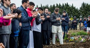 Abderrahmane Raguaragu, centre, from Ballinteer at his son's funeral at the Muslim cemetery in Newcastle, Co Dublin. Azzam Raguragui (18) was stabbed to death in Dundrum, Co Dublin, last week. Photograph: James Forde/The Irish Times