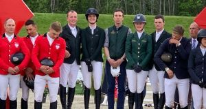 The victorious Irish team of Ger O'Neill, Susan Fitzpatrick, Shane Carey (ehef d'equipe), Jenny Rankin and Aidan Killeen stand on the podium following the Drammen Nations' Cup in Norway. Photograph: Margie McLoone