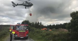 A helicopter takes water to the site of a fire in the Slieve Bloom mountains last year. Photograph: Laois Fire and Rescue/Twitter