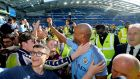 """Vinny"" is surrounded by Manchester City fans. He is a legend at the club. Photograph: PA"
