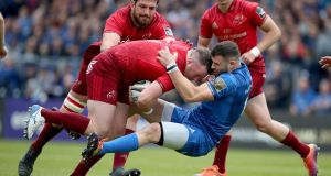 Leinster's Robbie Henshaw tackles Dave Kilcoyne of Munster