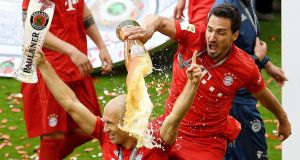 Mats Hummels pours a beer over Arjen Robben as they celebrate winning the Bundesliga. Photograph: Reuters