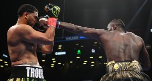 Deontay Wilder lands a straight left  on  Dominic Breazeale during their the WBC heavyweight title at Barclays Center on  in New York City on Saturday night. Photograph: Al Bello/Getty Images