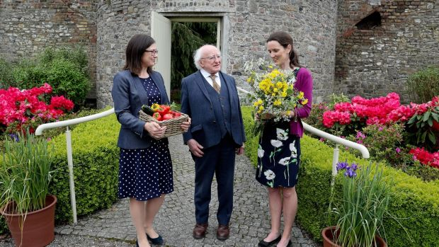 President Michael D Higgins, with on left Prof Jane Stout, Professor in botany at Trinity College and Dr Una FitzPatrick of the National Biodiversity Data Centre, in the gardens of Áras an Uachtaráin. Photograph: Maxwell's