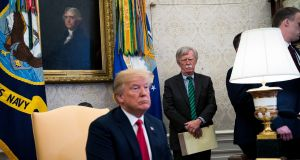 John Bolton, the US national security adviser, looking on from the background as President Donald Trump meets with Nato secretary general Jens Stoltenberg at the White House. Photograph: Doug Mills/The New York Times