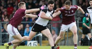 Sligo's Darragh Cumminsis challenged by  Eoghan Kerin and Gareth Bradshaw of Galway during the Connacht SFC semi-final at  Markievicz Park. Photograph: Evan Logan/Inpho