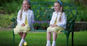BLUEBELLS: Sisters Olivia (7) and Zara (6) Duff, from Clondalkin, attend St Luke's Cancer Care hospital's annual Bluebell Garden event in Rathgar. Photograph: Dave Meehan/The Irish Times