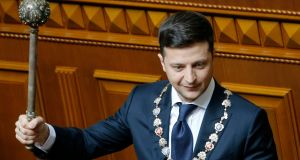 Ukrainian president Volodymyr Zelenskiy holds a mace, the Ukrainian symbol of power, during his inauguration ceremony in Kiev on Monday. Photograph: PA
