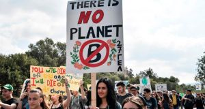 School students in Athens take part in a demonstration to raise awareness about climate change. Photograph: Getty Images