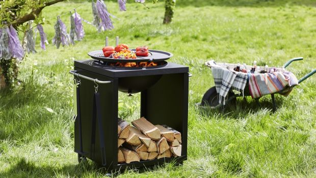 This Morso grill is adjustable in height and its grills can be swivelled aside to facilitate simultaneous barbecuing at two levels.