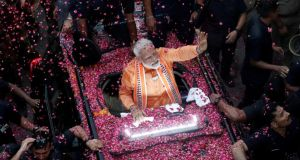 India's prime minister Narendra Modi waves to supporters during a roadshow in Varanasi, India on Paril 25th. Photograph: Adnan Abidi/File