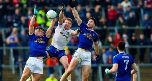 Cavan's Conor Brady and Thomas Galligan with Kieran Hughes of Monaghan contesting the ball in  Breffni Park,  Cavan. Photograph:  Tommy Dickson/Inpho