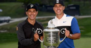 Brooks Koepka and  caddie Ricky Elliott with  the Wanamaker Trophy  at the Bethpage Black course in New York. Photograph: Ross Kinnaird/Getty Images