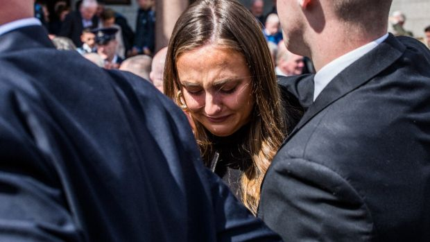 Niamh Lacey grieves at the loss of her uncle Anton O'Toole at the Mount Argus church in Dublin. Photograph: James Forde