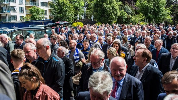 Mourners arrive at the funeral of famous Dublin footballer Anton O'Toole at the Mount Argus church in Kimmage. Photograph: James Forde