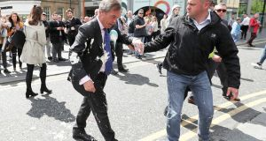 ROUGH AND TUMBLE: Brexit Party leader Nigel Farage after being hit with a flying milkshake after arriving for a campaign event in Newcastle, Britain. Photograph: Scott Heppell/Reuters