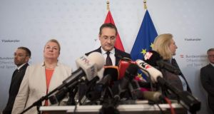 Heinz-Christian Strache (centre)  stood down as vice-chancellor and leader of the junior coalition Freedom Party (FPÖ) after secret recordings emerged that appeared to show him offering state contracts in exchange for dubious party donations. Photograph: Alex Halada/AFP/Getty