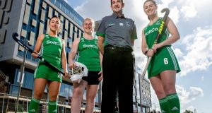Anna O'Flanagan, Róisín Upton and Ayeisha McFerran with newly appointed head coach Sean Dancer at the launch of the women hockey players' bursary scheme at the Reflector Building on Dubin's Grand Canal Dock. Photograph: Morgan Treacy/Inpho
