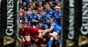 Scott Fardy (right) with Leinster clubmate Cian Healy and Munster's Conor Murray  (left) at the RDS last weekend. Photograph: Laszlo Geczo/Inpho