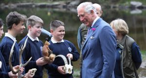 Oscar Stakem (centre, holding goat's skull) and fellow students from  Scoil Chaoimhín Naofa meet the Prince of Wales at Glendalough, Co Wicklow. Photograph: Owen Humphreys/EPA