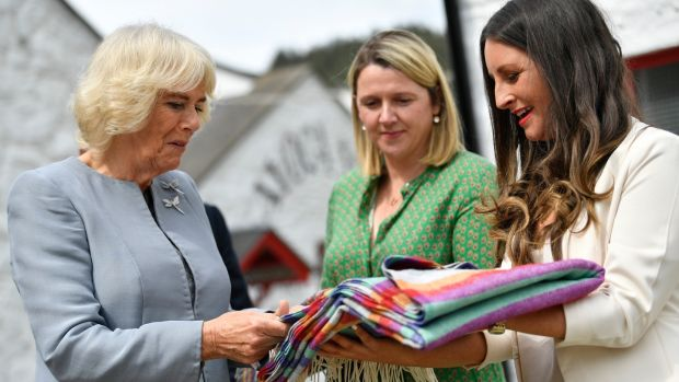 Camilla, Duchess of Cornwall receives a gift of a blanket for the Duke and Duchess of Sussex's son Archie as she visits the Avoca Mill on May 21st. Photograph: Neil Hall - Pool/Getty Images