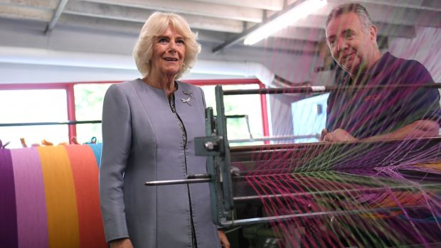 Camilla, Duchess of Cornwall is shown a loom as she visits the Avoca Mill in Co Wicklow, on May 21st. Photograph: Neil Hall - Pool/Getty Images