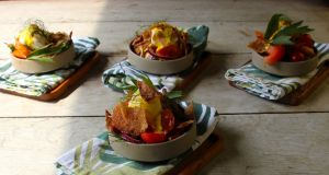 Vine tomato fattoush with poached eggs and saffron yoghurt.