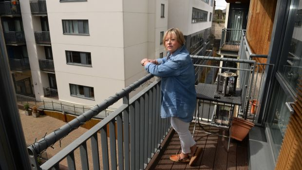 Gabrielle Kavanagh on a balcony at Cathedral Court, Dublin 8. Photograph: Dara Mac Dónaill/The Irish Times