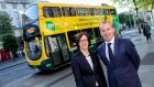 Dublin Bus chief executive Ray Coyne and NTA chief executive Anne Graham take delivery of the first hybrid double-decker buses at the  O'Connell Street headquarters of Dublin Bus on Tuesday. Photograph: Dublin Bus