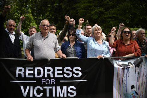 CLERICAL ABUSE: Protesters gather outside Castle Coole in Enniskillen, Co Fermanagh, ahead of the arrival of Charles, the Prince of Wales, and Camilla, the Duchess of Cornwall.  The protesters were angered at delays to a compensation package for child victims of clerical abuse in residential institutions. Photograph: Joe Giddens/PA Wire