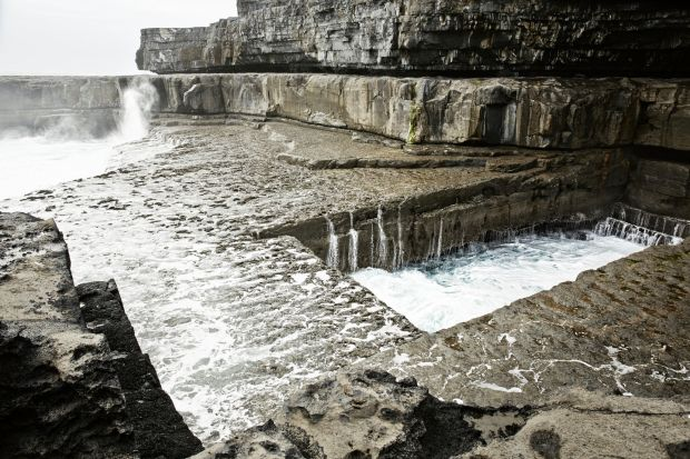 Poll na bPéist (the Wormhole): wild swimmers often have the natural pool to themselves at high tide on Inis Mór