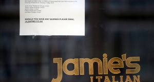 It's Oliver now: A sign on the window of a London outlet informs passersby that Jamie's Italian has gone into administration. Photograph: Hannah McKay/Reuters